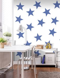 Trendy wallpaper for kids' room: white wall mural with oversized stars - pattern also available in beige and red