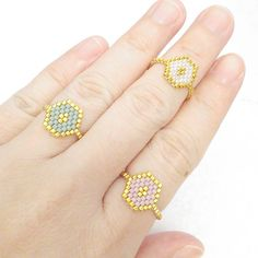 Beaded ring Peyote ring Definitely an all-time favorites. In velvety mint and gold ring that has an instant romantic and luxe feel with detail work of a focal gold Bead Loom Patterns, Beaded Jewelry Patterns, Beading Patterns, Seed Bead Jewelry, Seed Bead Earrings, 24k Gold Ring, Seed Bead Projects, Skinny Rings, Bracelets