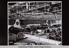 Three Pan American DC-7 planes in Douglas Aircraft Company Santa Monica plant, August 20, 1962