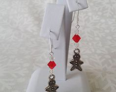 Distinctive Christmas tree earrings using Swarovski daisy spacer beads, bicones and cubes to form a Christmas tree charm. These trees are a lovely