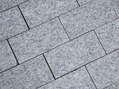 Silver Grey Sawn Granite Setts are a stylish solution for paths and for creating a contrasting edging or border, especially when paired with a darker stone such as Black Basalt or Midnight Black Limestone. Patio Material Ideas, Granite Paving, Front Gardens, Paving Stones, Driveways, Contemporary Landscape, Grey Stone, Pathways, Landscape Architecture