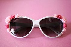 White sunglasses with rose and pearl cabochons.  Each cabochon is attached by hand.