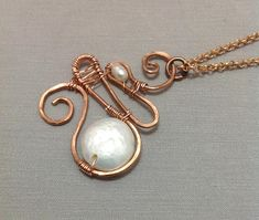 Natural Flat Pearl Pendant made of Copper Wire Wrapped One of