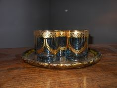 6 1960's whisky tumblers. Blue glass with gold pattern overlay.