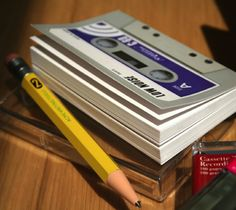 Cassette Tape Notebook / The cassette tape notebook a writing pad which is the actual size of an audio cassette. http://thegadgetflow.com/portfolio/cassette-tape-notebook-4/