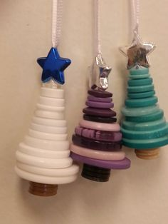 Handmade button Christmas tree ornaments. Made with ribbon, buttons, and acrylic beads. Choice of button color and star color. No two are exactly alike. Tree trunk color will vary with ornament. If you are looking for a particular color, please contact me and I will see what I can
