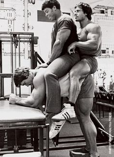 Mr. World Bill Grant and 2x Mr. Olympia Franco Columbu getting a ride courtesy of Arnold's calves.