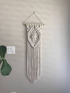 Macrame Wall Hanging - As seen in West Elm Stores This Custom Made Macrame Wall Hanging is simple, beautiful, modern and is sure to add interest to any space. It is made of 100% Cotton rope, measures 18 inches wide, is 45 inches long and hangs from an 18 inch Brass Rod. *****MADE TO ORDER - Please expect a 2-3 week turnaround Designed and Crafted in California Check out other Wall Hangings in my shop! https://www.etsy.com/shop/reformfibers?section_id=18178027