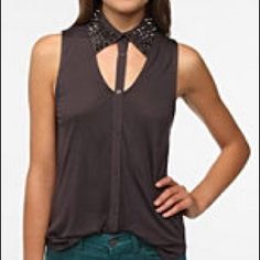 UO Studded Cut Out Collared Tank Edgy and sexy yet leaving some to the imagination, this studded collared, button up, cutout sleeveless blouse is a must for parties or simply looking sharp. Dark grey color--3rd pic is most accurate. Hand wash or machine wash on gentle. Perfect condition :) Urban Outfitters Tops Button Down Shirts