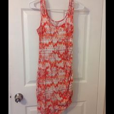 Orange side tie up guess tank dress Super cute dress.  Side tie up to show your awesome legs.  EUC.  Worn once Guess Dresses Mini