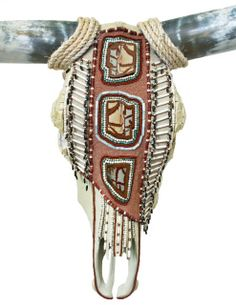 """The first in the Native American series, this skull includes Owyhee Picture Jasper, White Turquoise, Amazonite, Hairpipe Beads, Nut Beads, Glass Beads, Micro Beads, Suede and Smalti. Skulls are shipped with the horns off, but don't worry, they are easy to put back on.  31"""" W x 24"""" L x 21"""" D  Scroll down to view horns."""