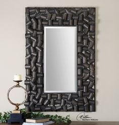 Trinita beveled mirror; frame is made of hand forged metal with an antiqued bronze finish with gold undertones. Mirrors We Love at Design Connection, Inc. | Kansas City Interior Designs http://www.DesignConnectionInc.com/Blog #Mirror #InteriorDesign