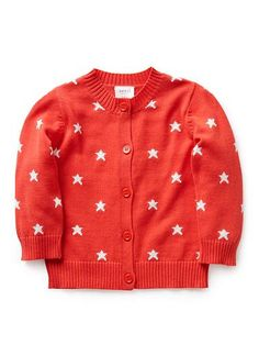 100% Cotton Cardigan. Fully fashioned, knit cardigan. Crew neck with button through front. Features all-over star. Available in Navy and Poppy Red.