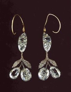 Matching diamond earrings worn on her wedding day.  They were so heavy that the wires had to be used to support them and they cut into the flesh they longer they were worn.