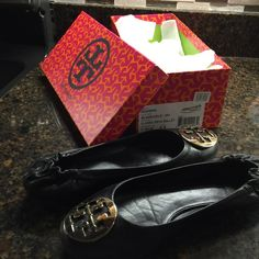 Authentic Tory Burch 8.5 women's black gold emblem Authentic Tory Burch black flats sz 8.5 with gold emblem. There is some wear on the toes but not noticeable. Thank you Tory Burch Shoes Flats & Loafers