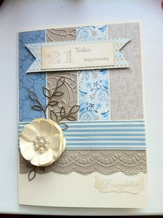 Love the strips of different papers, and the embossing