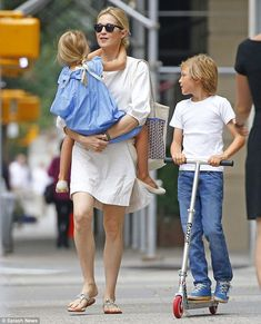 Back together again! Kelly Rutherford was reunited with her two children eight-year-old Hermes and six-year-old Helena on US soil on Friday in New York City