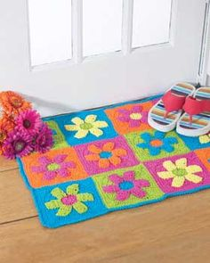 This funky flower power rug brings spring indoors and gives a splash of color to any room in your house. Fast, fun and easy to make. Approx. 23 x 31 in [58.5 x 78 cm]. Made in Lily Sugar'n Cream with size 4.5 mm (U.S. 7) crochet hook.-free pattern