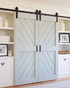 DIY Double Barn Door – Angela Marie Made How to build double DIY barn doors for a barn door entertainment center DIY, a great way to hide the TV. This DIY barn door is a perfect wall feature too! Double Sliding Barn Doors, Sliding Barn Door Hardware, Door Hinges, Barn Door Closet, Barn Doors For Closets, Barn Doors For Pantry, Barn Door For Bathroom, Sliding Door Closet, Barn Door Tv Cabinet