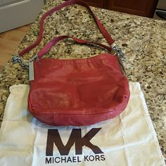 Michael Kors Shoulder Purse with Dust Bag Gorgeous red Michael Kors shoulder purse with awesome silver hardware.  Excellent condition with slight scuffing on bottom exterior(pictured). Dust bag included. Michael Kors Bags Shoulder Bags