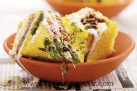 Dhokla Chaat: A new avtar of Dhokla. Dhokla served with yogurt and chutneys.