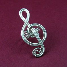 wire ear cuffs patterns | Jewelry Ideas | Project on Craftsy: Treble Clef Ear Cuffs #wirejewelry