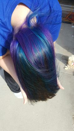 Underneath brown hair, with purple and blue