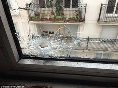 A picture posted on Twitter reportedly showing bullets in one of the windows of the Charlie Hebdo office
