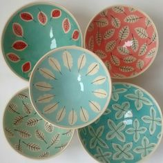 Colourful handmade ceramic bowls with decoration made of engobe and claybright.