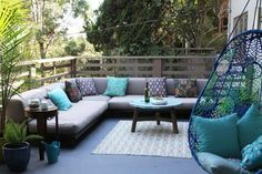 Love the sectional and hanging chair!  Links to Apartment Therapy's Guide to the Perfect Summer