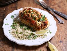 Striped delicata squash are piled high with a stuffing of cherry tomatoes, borlotti beans, fresh oregano and tangy feta, served on platefuls of warm, herby couscous. Abel And Cole, Coles Recipe, Stuffed Squash, Veg Patch, Squash Recipe, Eating Clean, Couscous, Cherry Tomatoes, Clean Eating