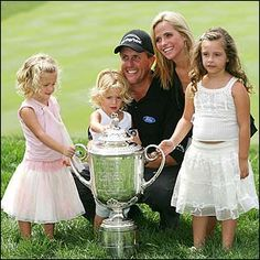 Phil Mickelson with his wife & daughters after his latest win.