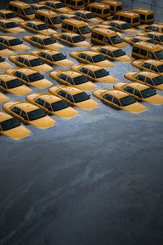 Taxis in a flooded lot in Hoboken, New Jersey, after superstorm Sandy. The storm caused massive flooding across much of the US Atlantic seaboard