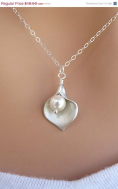 My love for calla lilies might just land me with one of these necklaces! & there's earrings to match!!