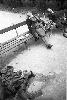 Vienna, 1945: Father shoots wife and daughter and then commits suicide. Eyewitnesses said father wore gold Nazi Party badge, indicative of senior Nazi party membership. Incident occurred across the Parliament building in the Austrian capital.