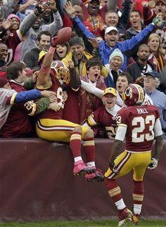 Washington #Redskins outside linebacker Ryan Kerrigan celebrates his touchdown during the first half.