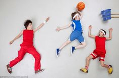 Three boys get stuck into a game of (bin) basketball - with one very high jumper about to ...