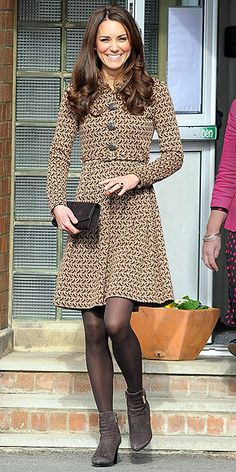 The Duchess of Cambridge keeps things all in the (color) family, wearing tights and accessories in the same hue as the bird print on her Orla Kiely dress.
