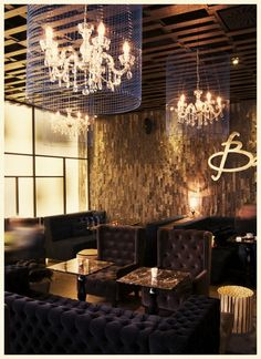 Eclectic coffee shop design - with classic chandeliers and creative wall sign