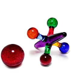 Cool!  GLASS JACKS | Vibrant, Colorful, Playful and Elegant Molten Glass Sculptures of Classic Ball and Jack Counting Game from Monique LaJeunesse | UncommonGoods
