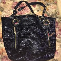 Beautiful large Steve Madden black leather purse! This is a huge tote, PERFECT for travel, laptops, clothes, school, etc. it's very sturdy, and beautiful! Pink interior. No damage. Steve Madden Bags Totes