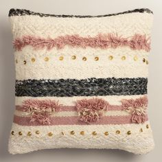 Inspired by the ancient art of Moroccan wedding blankets, our exclusive throw pillow recreates the look and feel with a cozy shag texture and decorative sequins. Bring one home while you can - only a limited number are available.