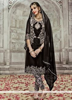 Be the sunshine of anyone's eyes dressed in this black georgette designer suit. The fantastic dress creates a dramatic canvas with unbelievable embroidered and resham work. Comes with matching botto...