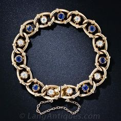 Sapphires do not come any bluer (or old mine-cut diamonds much more brilliant) than the beautiful gemstones glistening in this exceptional late-Victorian bracelet, finely crafted in radiant 15 karat rose gold. Each gemstone is displayed in a stylized buttercup setting centered inside slightly torqued, pretzel-twisted oval links adorned with bracket accents. Simply gorgeous.