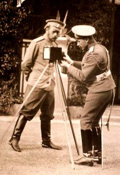 This is a photograph of Tsar Nicholas II inspecting a camera. Photography was one of the Imperial Family's favorite pastimes.