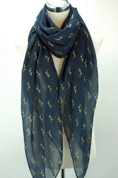 This is a gorgeous Beagle print scarf, perfect for dog lovers and ideal as a gift and available in blue and cream.  http://www.felixandfido.co.uk/dogs/scarves/beagle-print-scarf.html