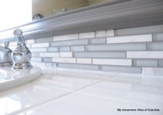 how to update a bathroom backsplash with glass tile. I love this tile!