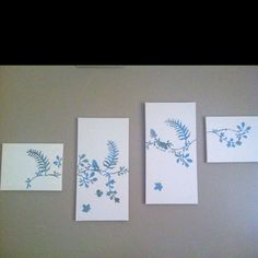 Paint 4 canvases a solid color... Use stencils to create various patterns on scrapbook paper and cut them out... Lay out the designs on the canvas and then Mod podge the designs onto the canvas... Mod podge over all the designs after they are placed on the canvas!