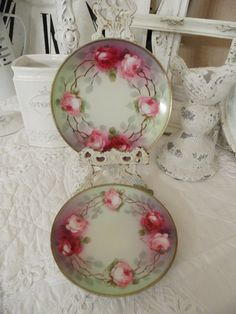 pink roses plates on a pale green background