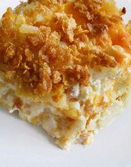 Cheesy Potato Casserole - frozen hash browns, butter, onion, chicken soup, sour cream, cheddar cheese, corn flakes